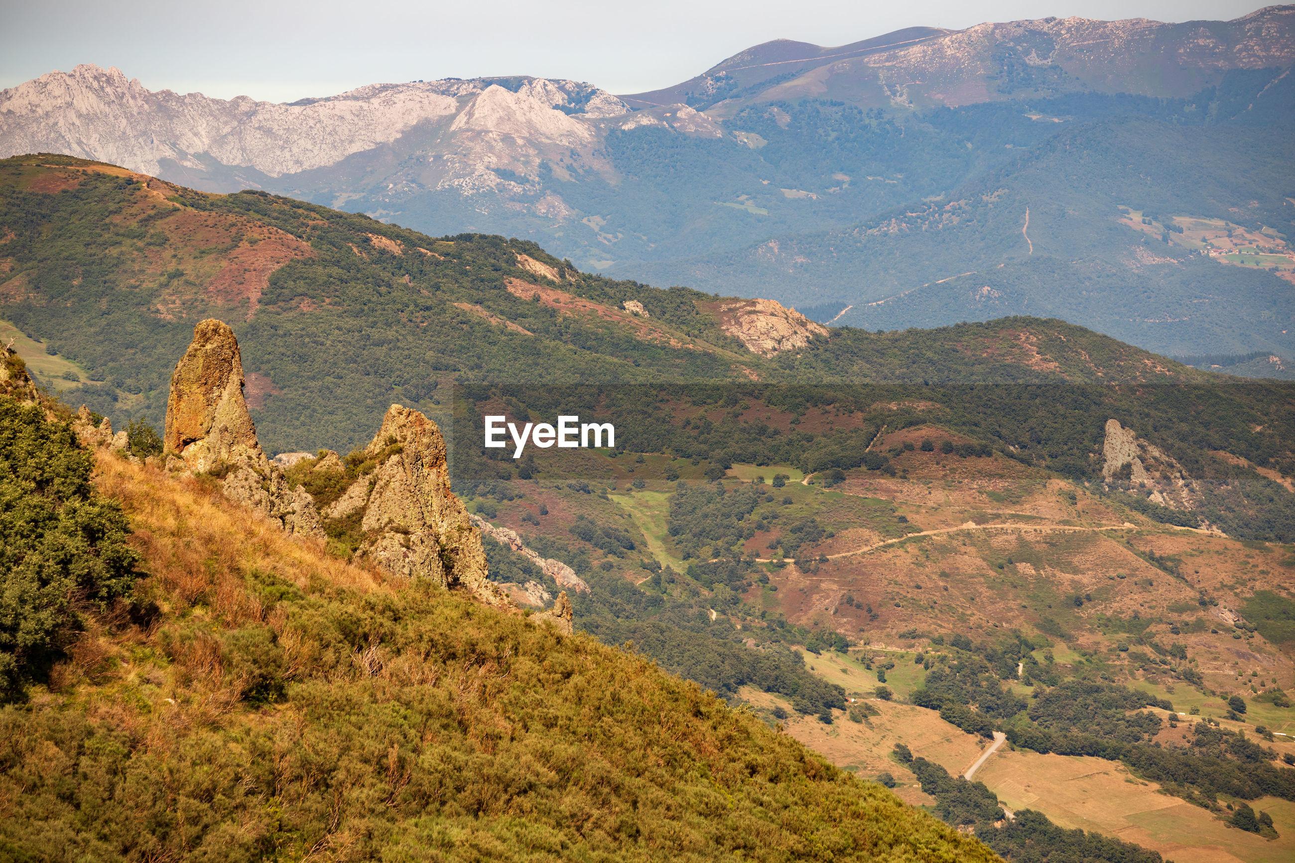 Scenic view across mountain range against sky
