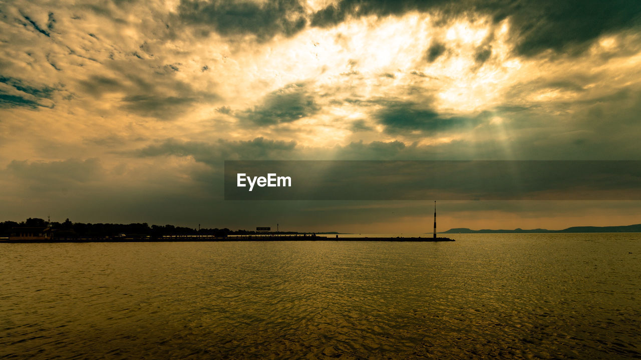 sky, water, cloud - sky, sunset, sea, scenics - nature, nautical vessel, beauty in nature, waterfront, nature, tranquil scene, no people, sunlight, transportation, tranquility, silhouette, idyllic, outdoors, sun, sailboat