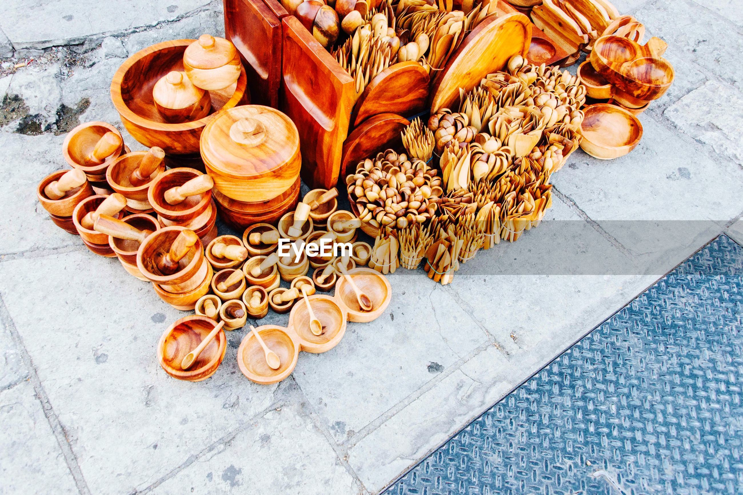 High angle view of wooden kitchen utensils for sale at market