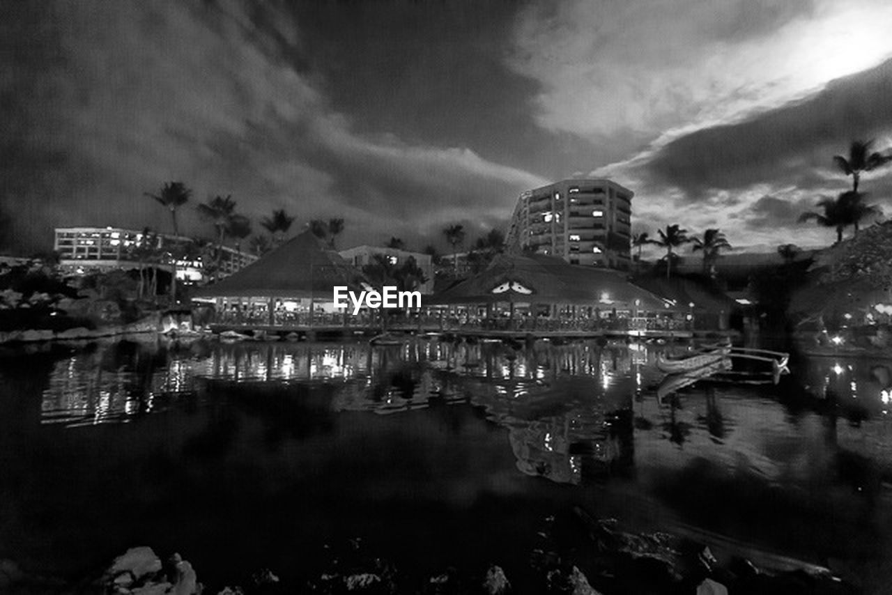 reflection, cloud - sky, sky, water, architecture, illuminated, built structure, building exterior, night, waterfront, outdoors, no people, nature, beauty in nature