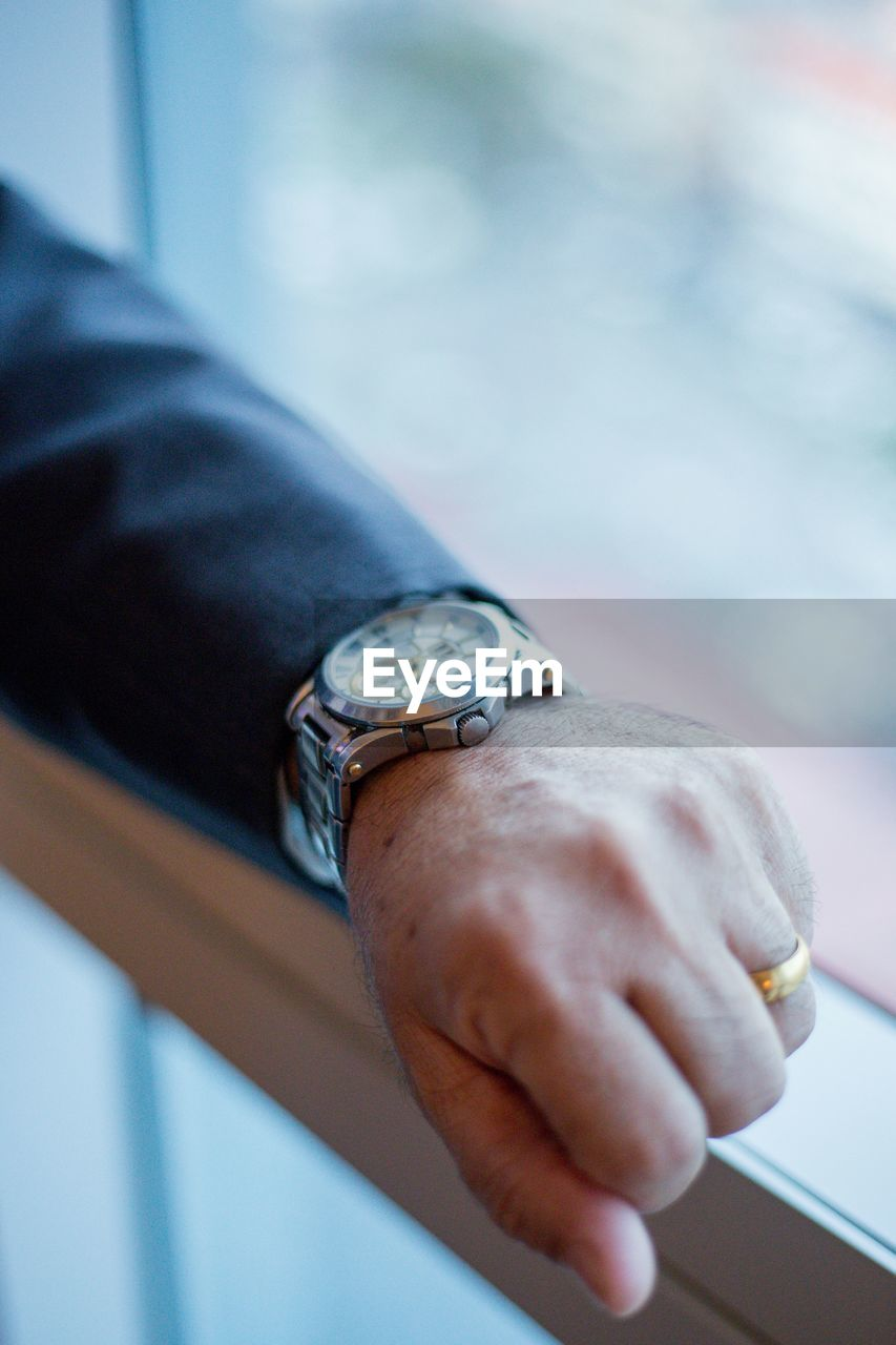 Cropped Hand Of Man Wearing Wristwatch