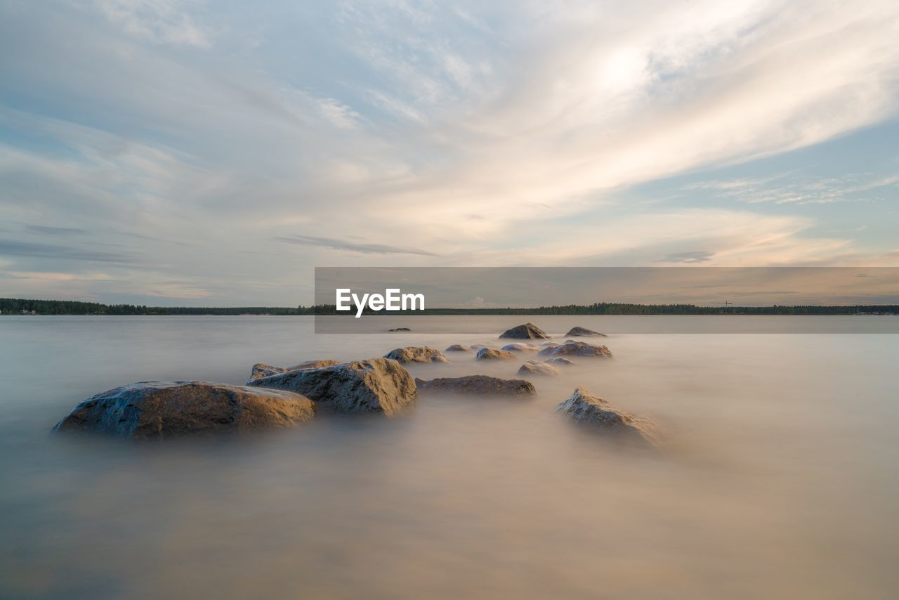 water, sky, cloud - sky, scenics - nature, beauty in nature, tranquility, tranquil scene, sea, sunset, nature, idyllic, rock, solid, no people, rock - object, non-urban scene, long exposure, outdoors, beach