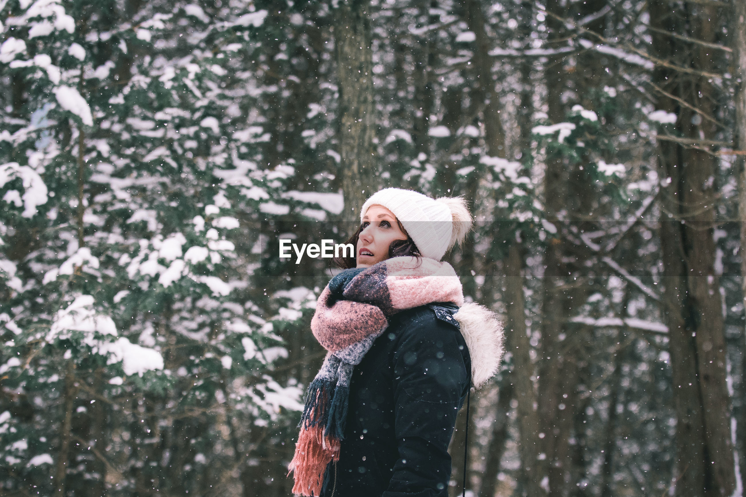 Woman in forest during snowfall