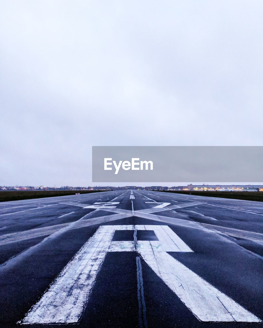 transportation, outdoors, road, asphalt, day, airport runway, no people, sky, nature, landscape, airplane
