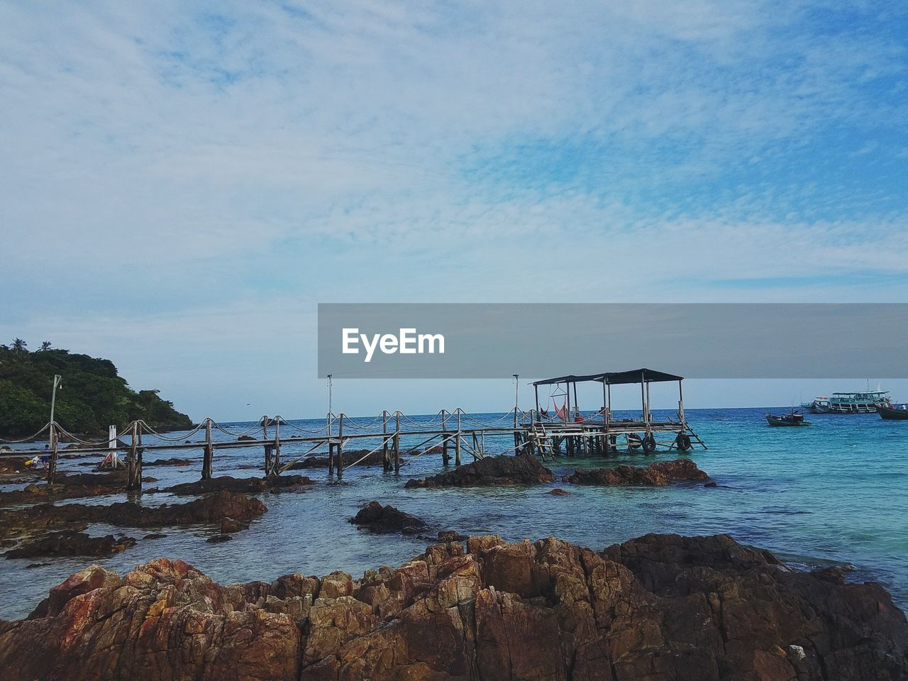 water, sky, sea, rock, architecture, cloud - sky, rock - object, beauty in nature, solid, nature, built structure, scenics - nature, beach, day, no people, land, tranquil scene, transportation, outdoors