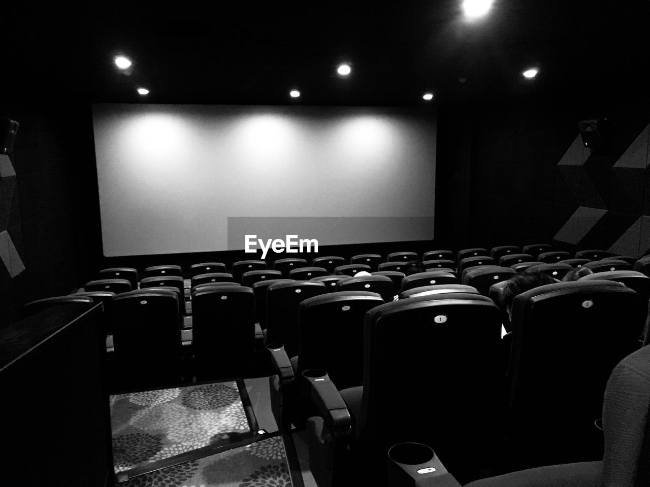 movie theater, arts culture and entertainment, indoors, in a row, illuminated, chair, film industry, seat, projection equipment, auditorium, movie, no people, day