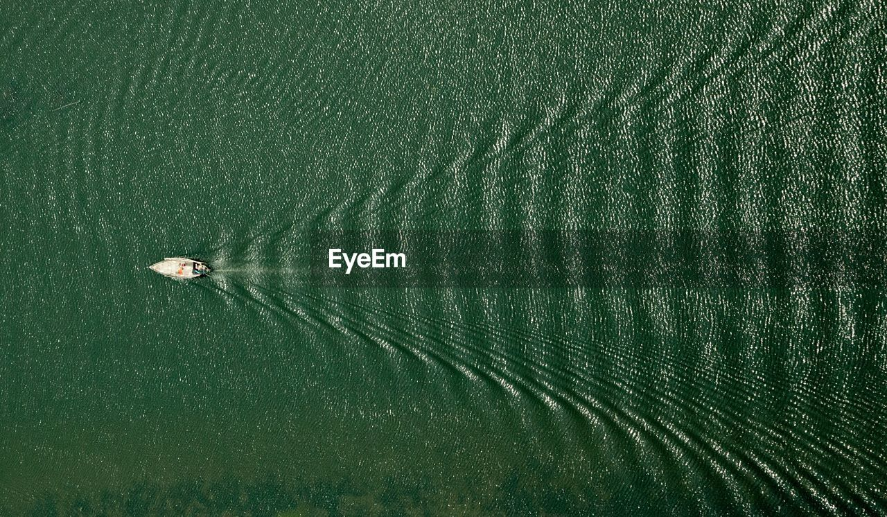 Directly above shot of boat sailing in sea