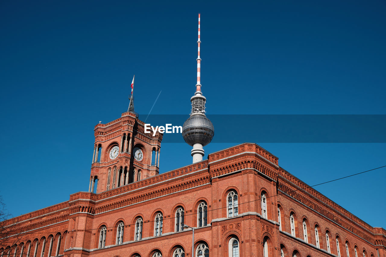 sky, building exterior, built structure, architecture, clear sky, blue, low angle view, travel destinations, travel, tourism, nature, tower, building, city, no people, tall - high, copy space, sunlight, spire