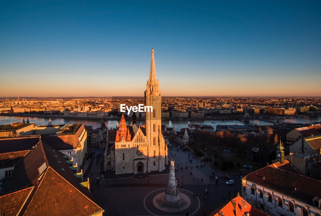 architecture, built structure, cityscape, building exterior, high angle view, copy space, outdoors, travel destinations, no people, clear sky, city, history, spirituality, blue, sky, day, illuminated
