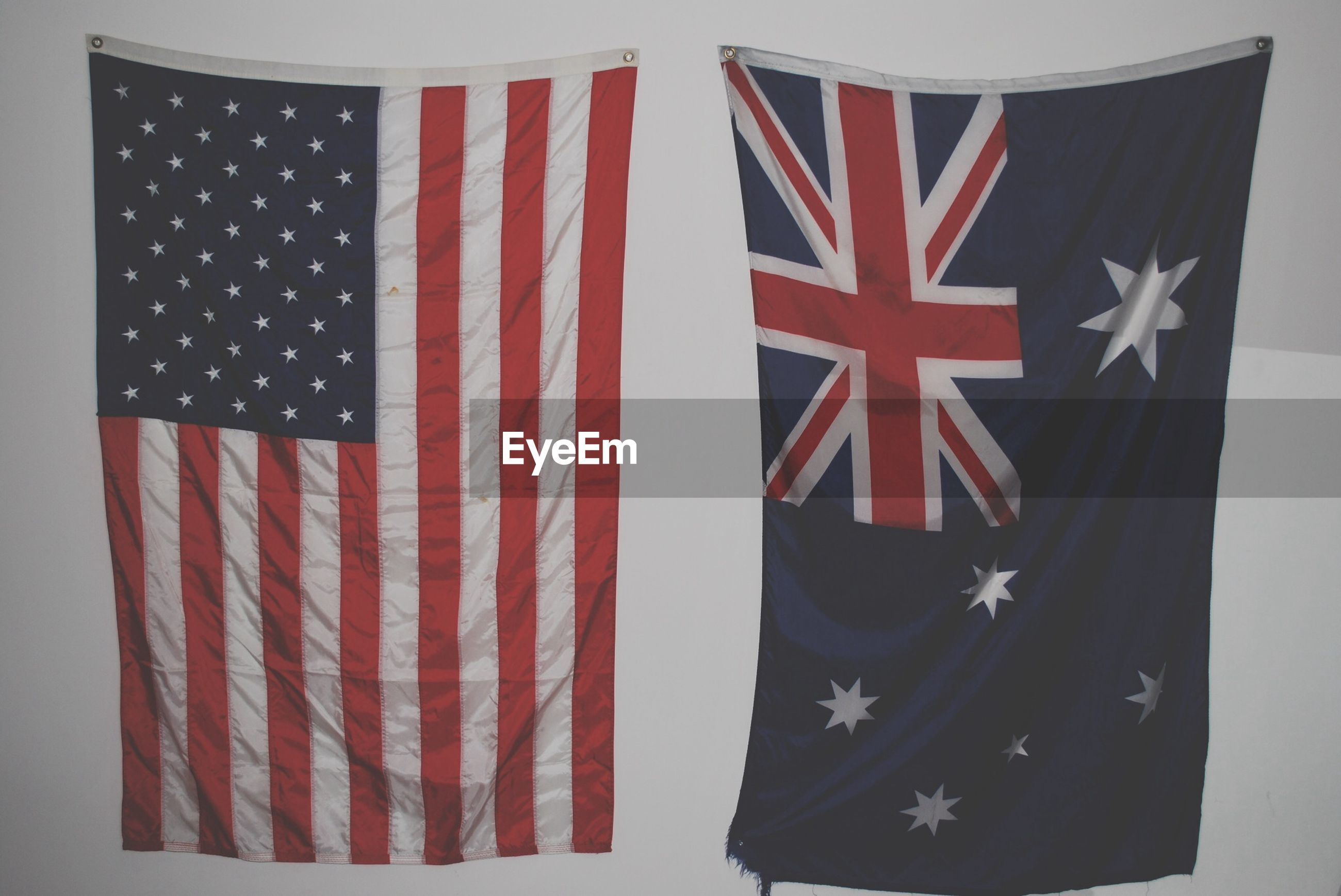 patriotism, flag, identity, red, american flag, national flag, striped, textile, fabric, white color, culture, indoors, star shape, close-up, pride, no people, pattern, paper, hanging, design