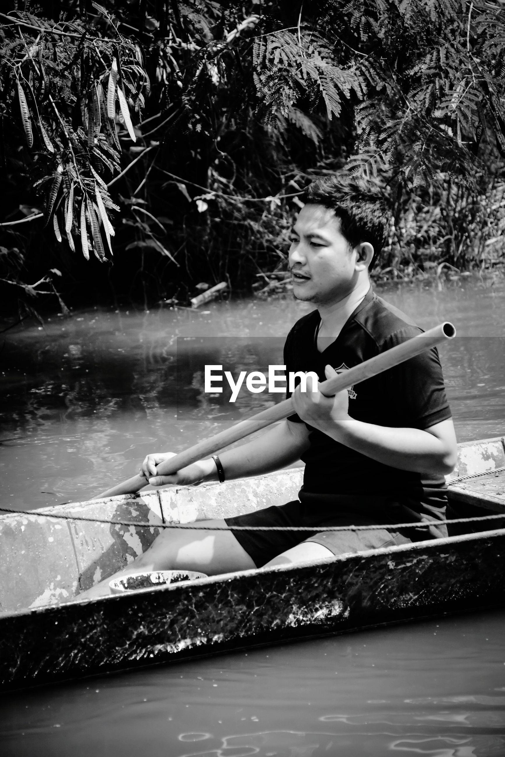 Man rowing boat on lake