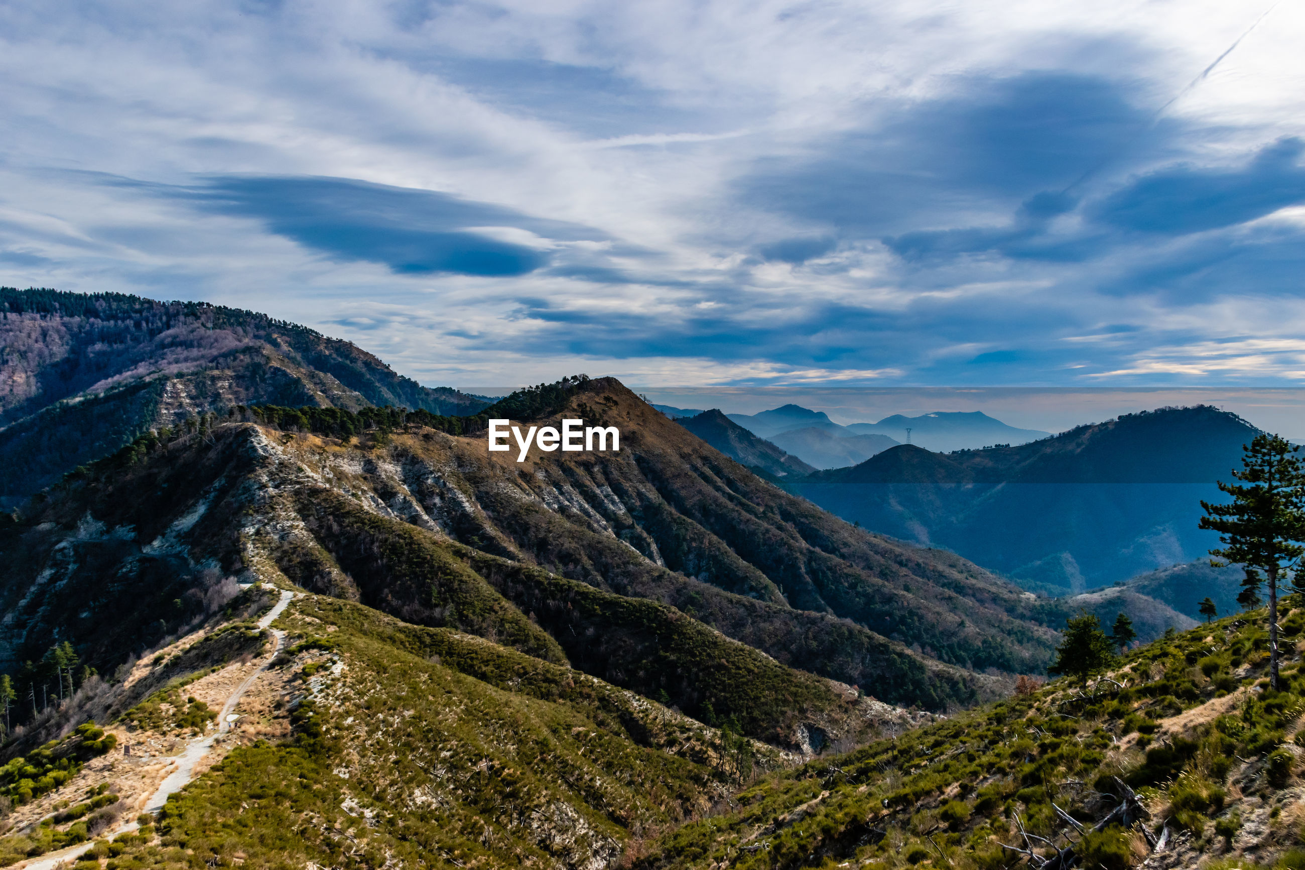 SCENIC VIEW OF VALLEY AGAINST SKY