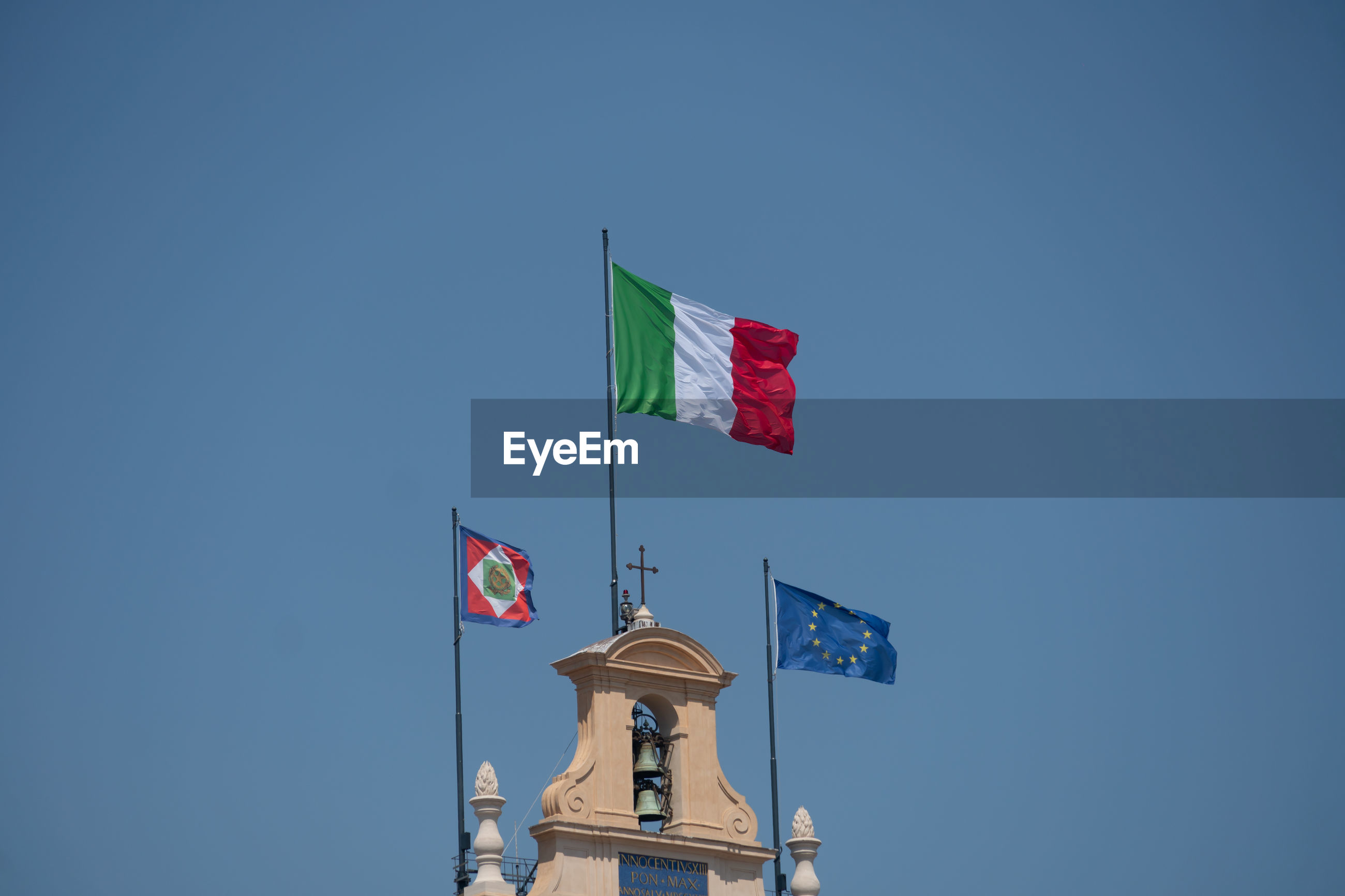 European and italian flags and italian presidential pennant waving outside the quirinale palace