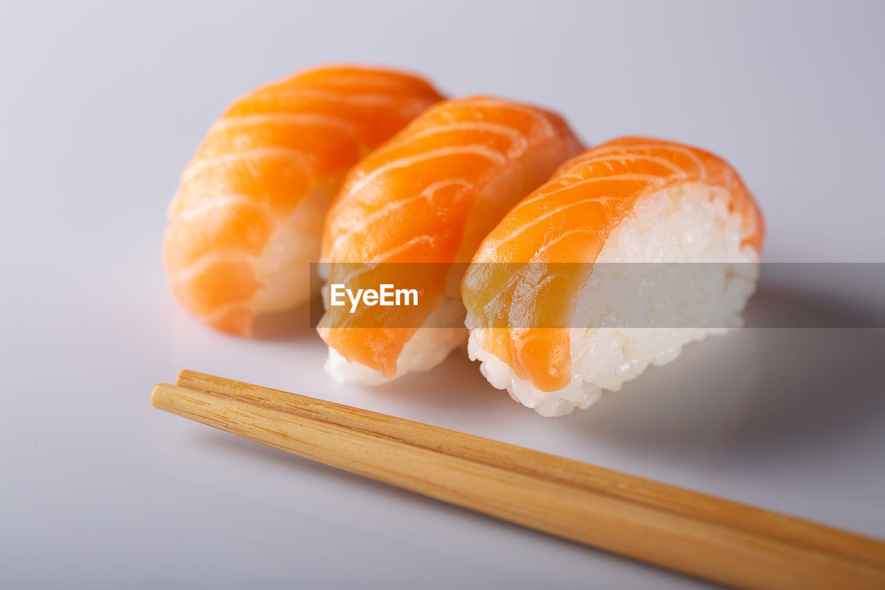 food, studio shot, freshness, food and drink, indoors, japanese food, asian food, white background, close-up, sushi, wellbeing, orange color, ready-to-eat, still life, healthy eating, no people, rice, serving size, salmon - seafood, temptation, caviar