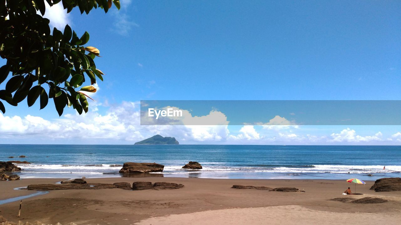 sky, sea, land, beach, water, cloud - sky, beauty in nature, scenics - nature, sand, nature, tree, day, horizon, horizon over water, tranquility, tropical climate, plant, tranquil scene, palm tree, no people, outdoors, coconut palm tree