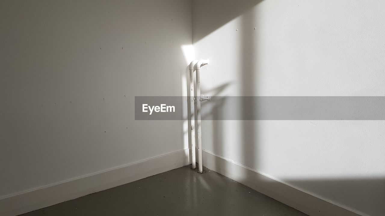 indoors, wall - building feature, no people, domestic room, white color, burning, home interior, domestic bathroom, bathroom, home, illuminated, heat - temperature, flame, architecture, fire, nature, lighting equipment, flooring, fire - natural phenomenon, corner