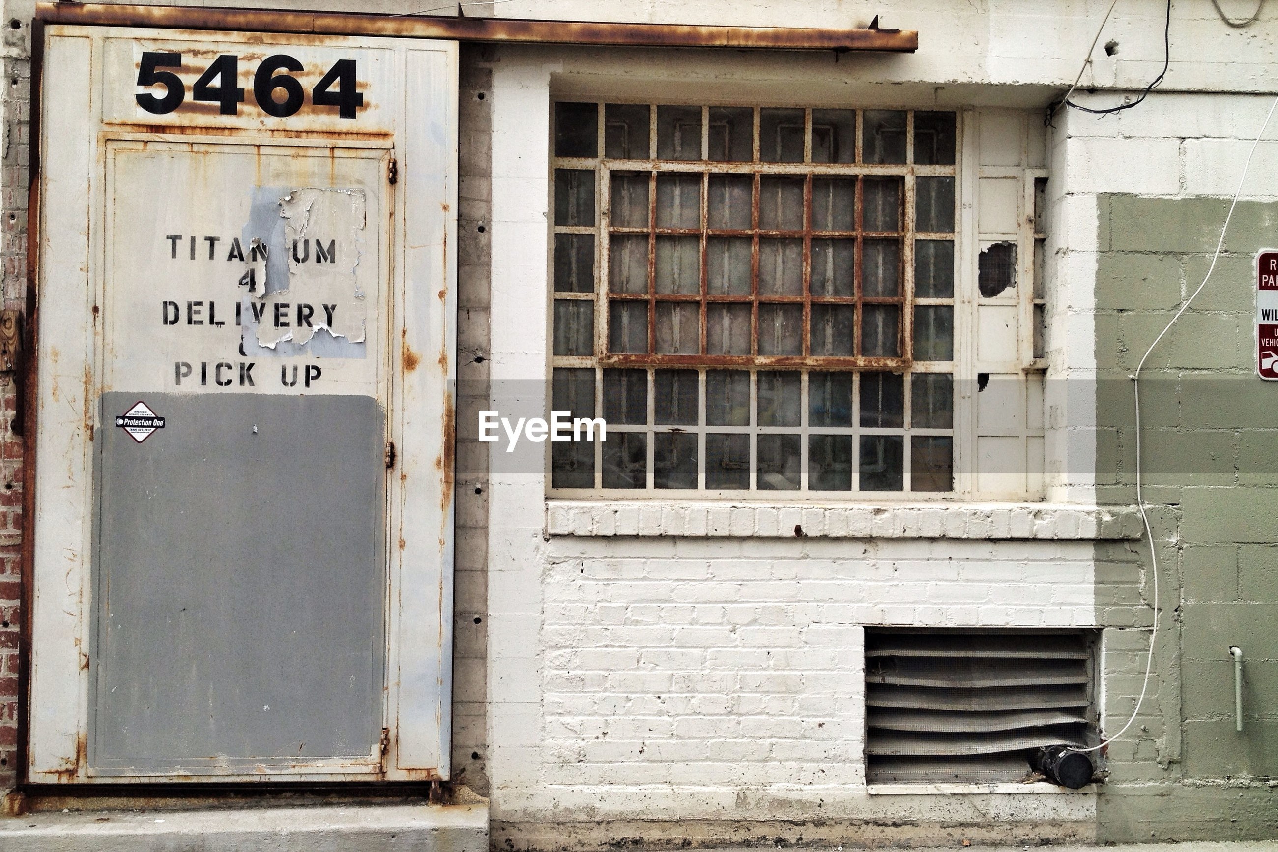 View of warehouse with closed door and window