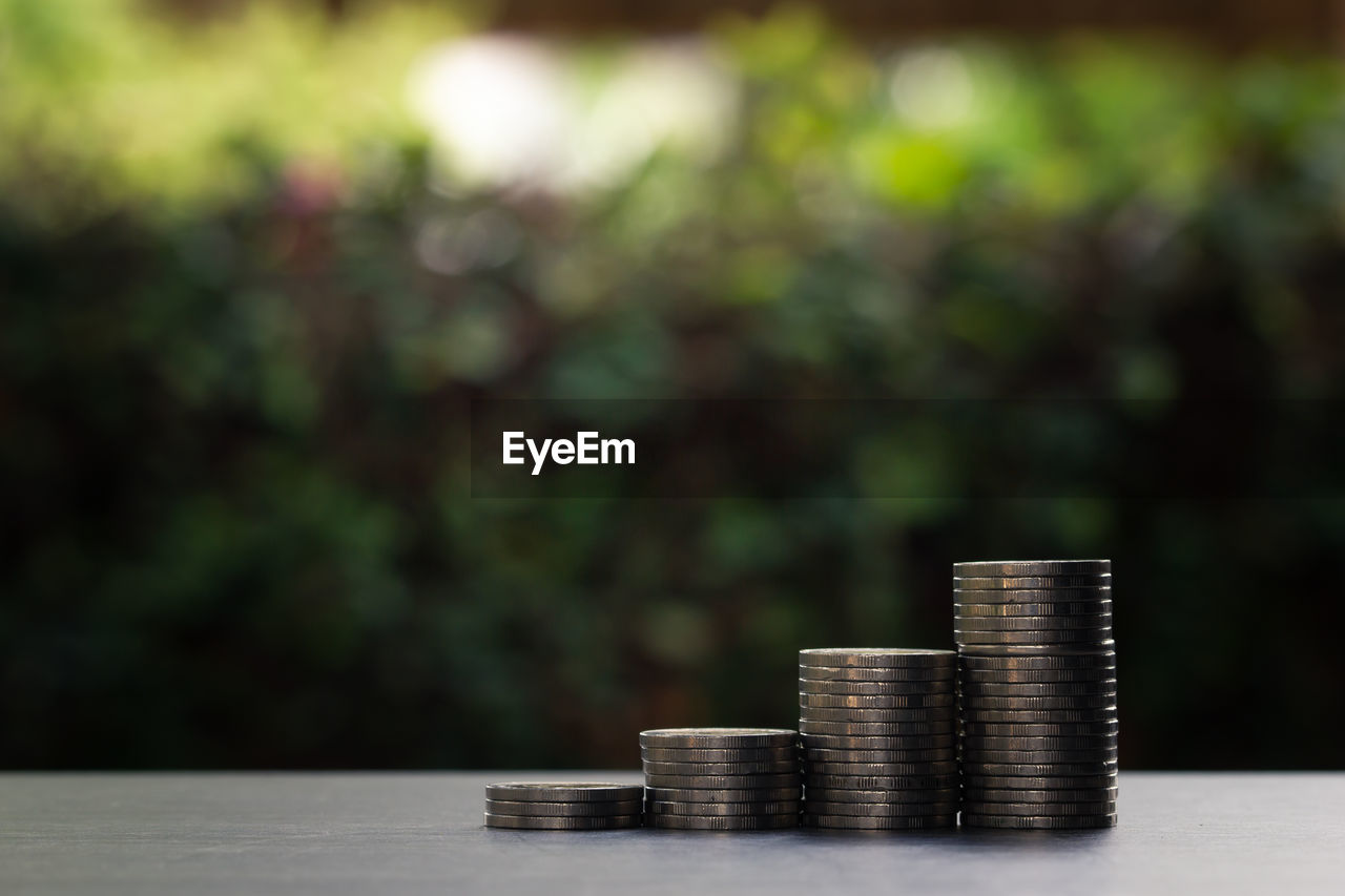stack, coin, finance, table, currency, business, savings, metal, wealth, growth, no people, large group of objects, focus on foreground, investment, still life, nature, selective focus, wood - material, arrangement, day, economy, making money, silver colored