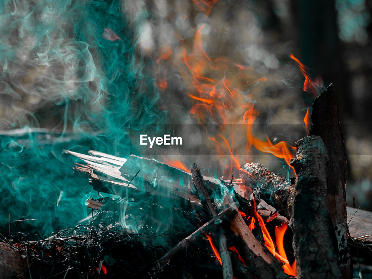 burning, smoke - physical structure, fire, fire - natural phenomenon, heat - temperature, flame, motion, nature, no people, orange color, day, land, blurred motion, environment, wood - material, glowing, outdoors, long exposure, wood, firewood, bonfire, air pollution, pollution