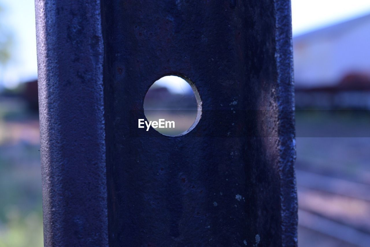 close-up, metal, focus on foreground, outdoors, no people, day, water, nature