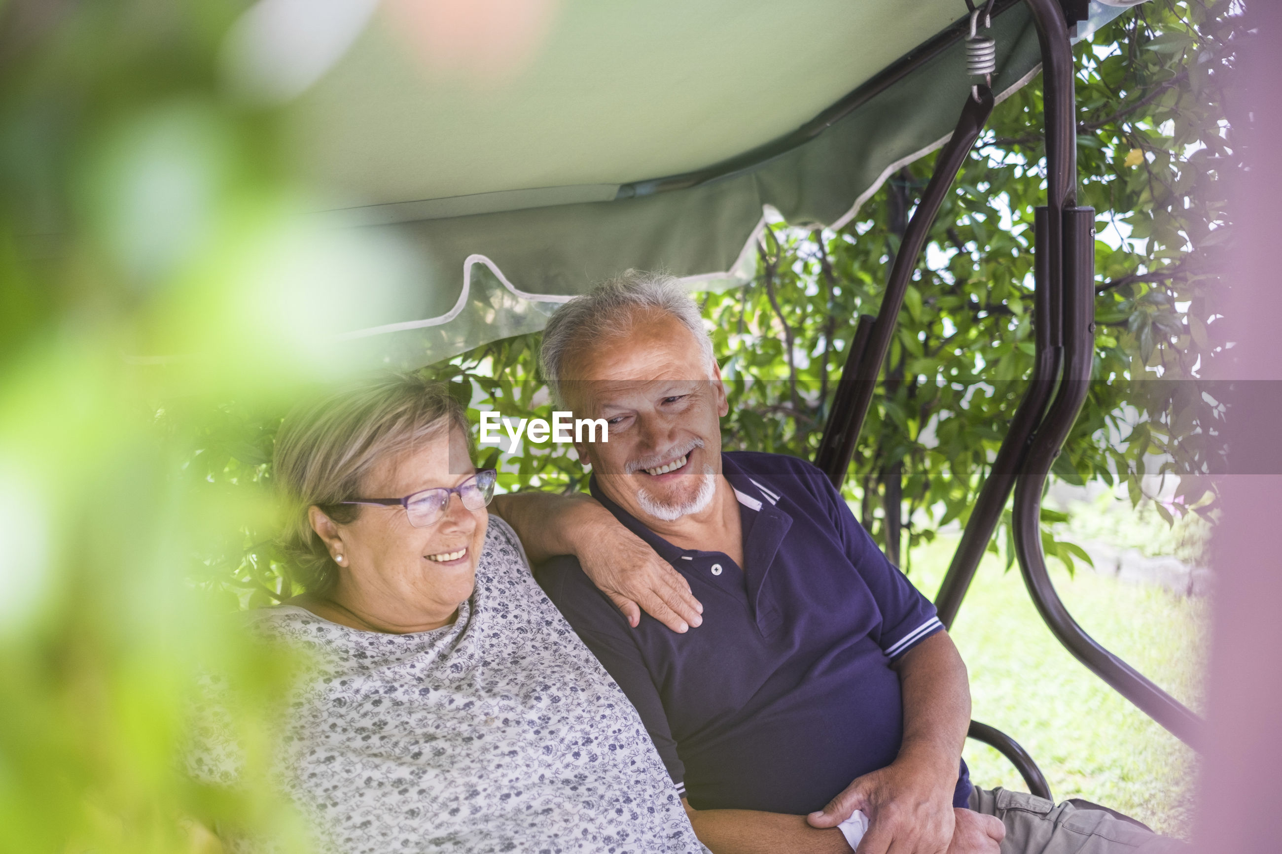 Smiling senior couple sitting on seat
