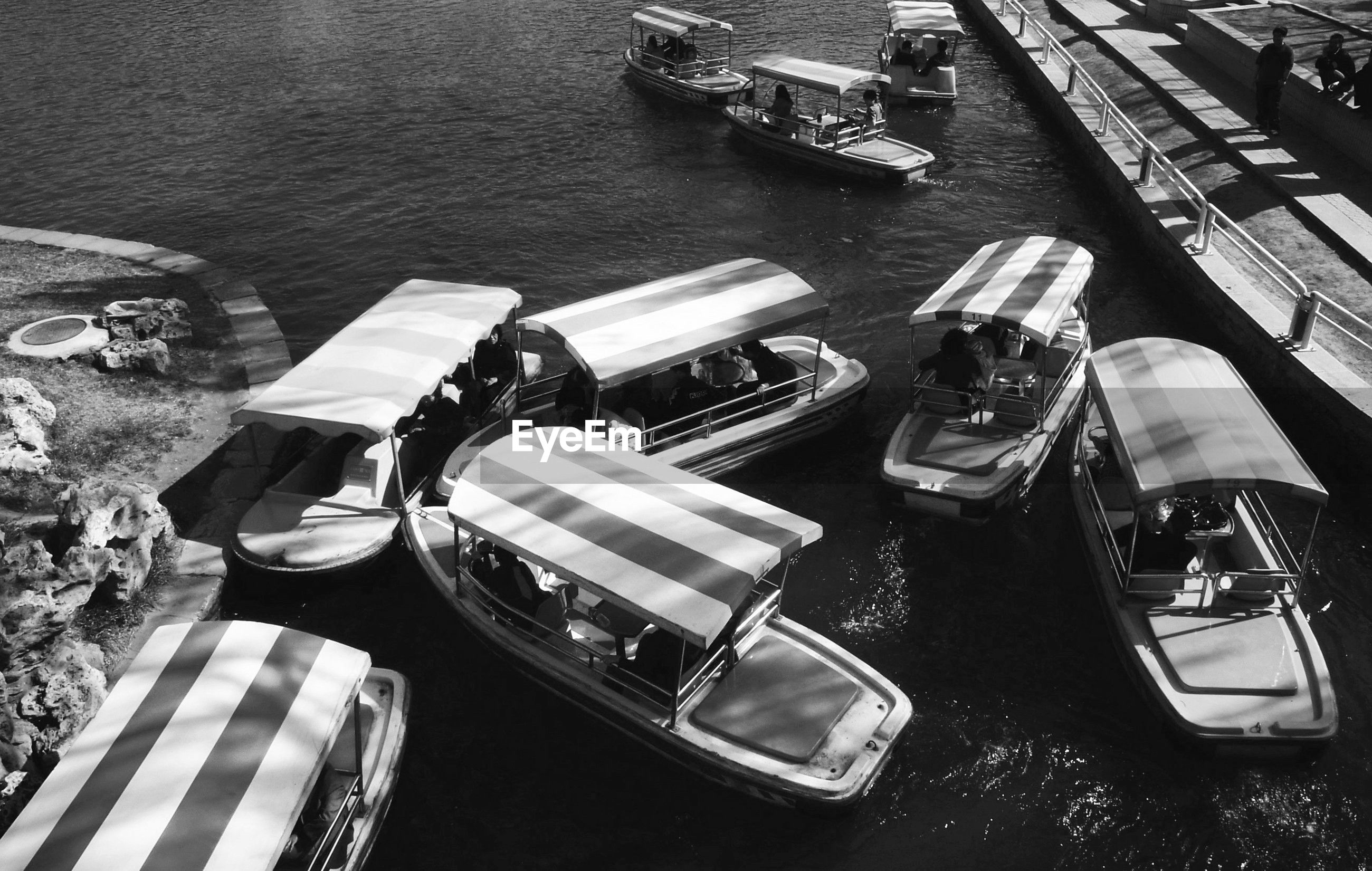 High angle view of boats on lake by park