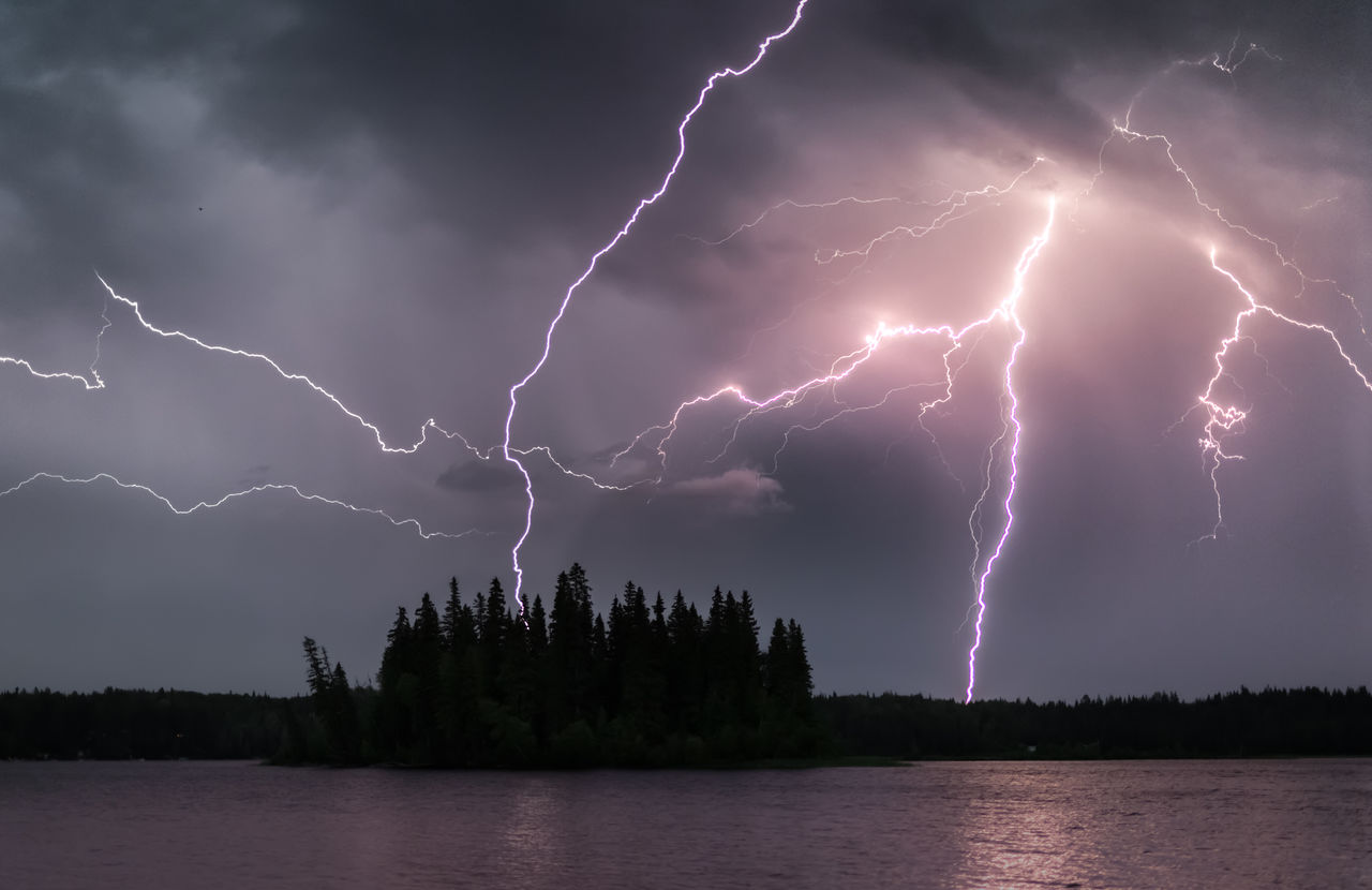 cloud - sky, storm, lightning, power in nature, beauty in nature, sky, power, thunderstorm, scenics - nature, water, nature, tree, no people, forked lightning, night, storm cloud, waterfront, warning sign, outdoors, electricity, purple