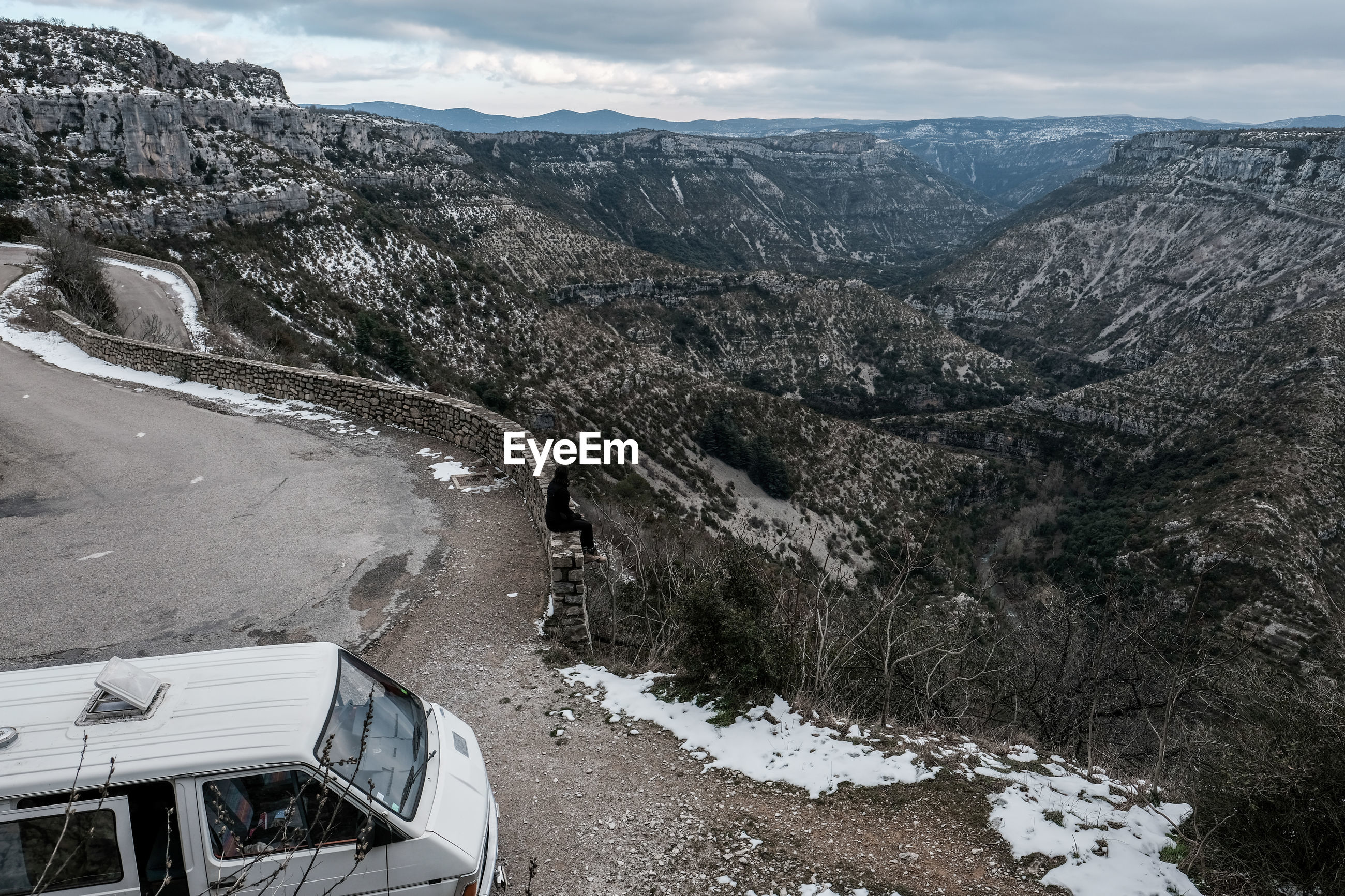 mountain, scenics - nature, beauty in nature, cold temperature, winter, snow, nature, transportation, environment, mountain range, day, non-urban scene, no people, road, tranquil scene, landscape, tranquility, mode of transportation, high angle view, outdoors, snowcapped mountain, formation