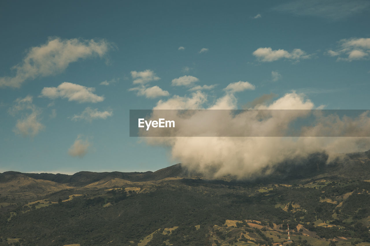 cloud - sky, sky, beauty in nature, scenics - nature, mountain, tranquil scene, tranquility, non-urban scene, environment, landscape, nature, smoke - physical structure, no people, day, land, geology, physical geography, volcano, idyllic, emitting, outdoors, power in nature, pollution, volcanic crater, arid climate
