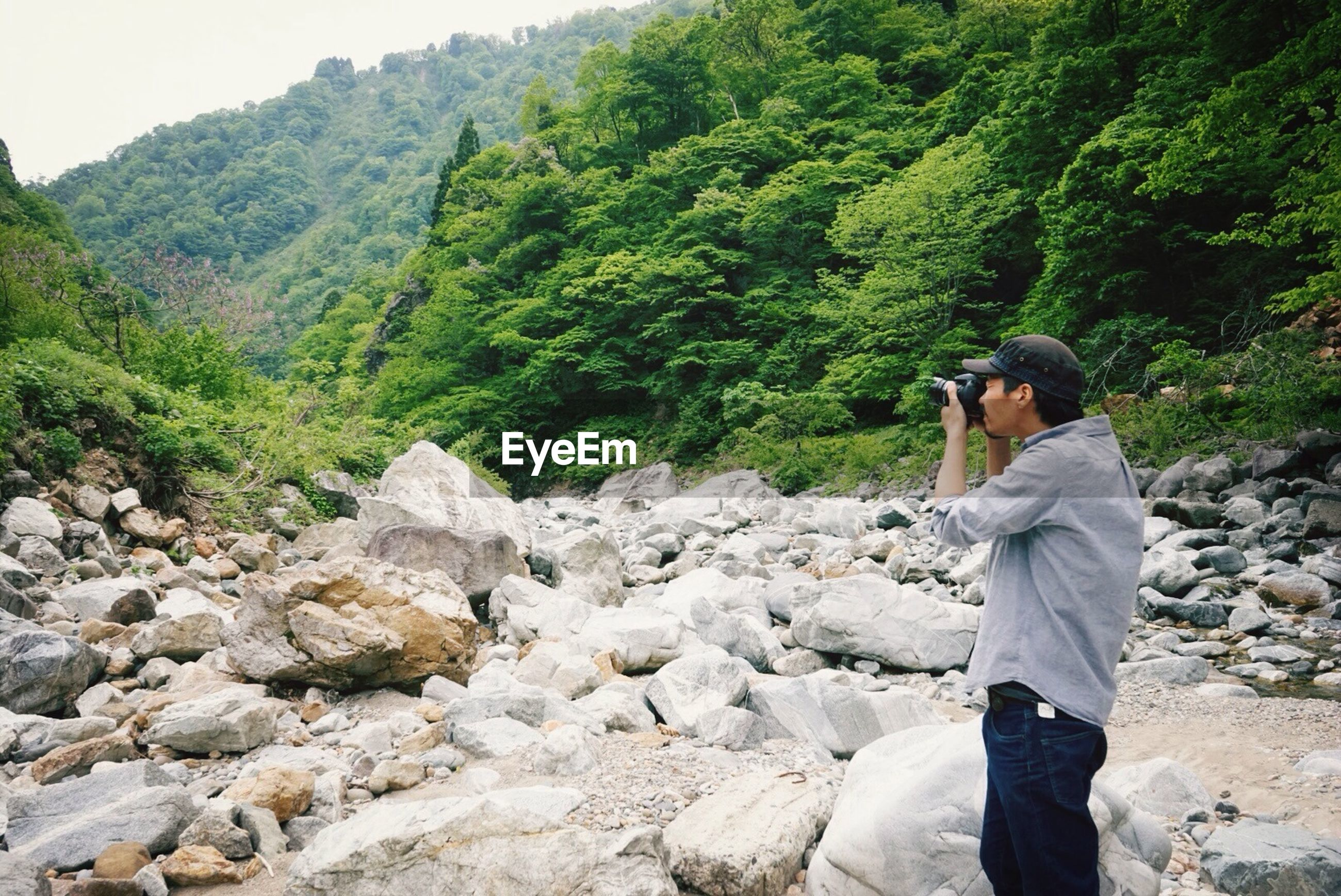 lifestyles, leisure activity, mountain, rock - object, men, casual clothing, hiking, standing, full length, nature, rear view, backpack, adventure, landscape, rock formation, tranquility, rock, person