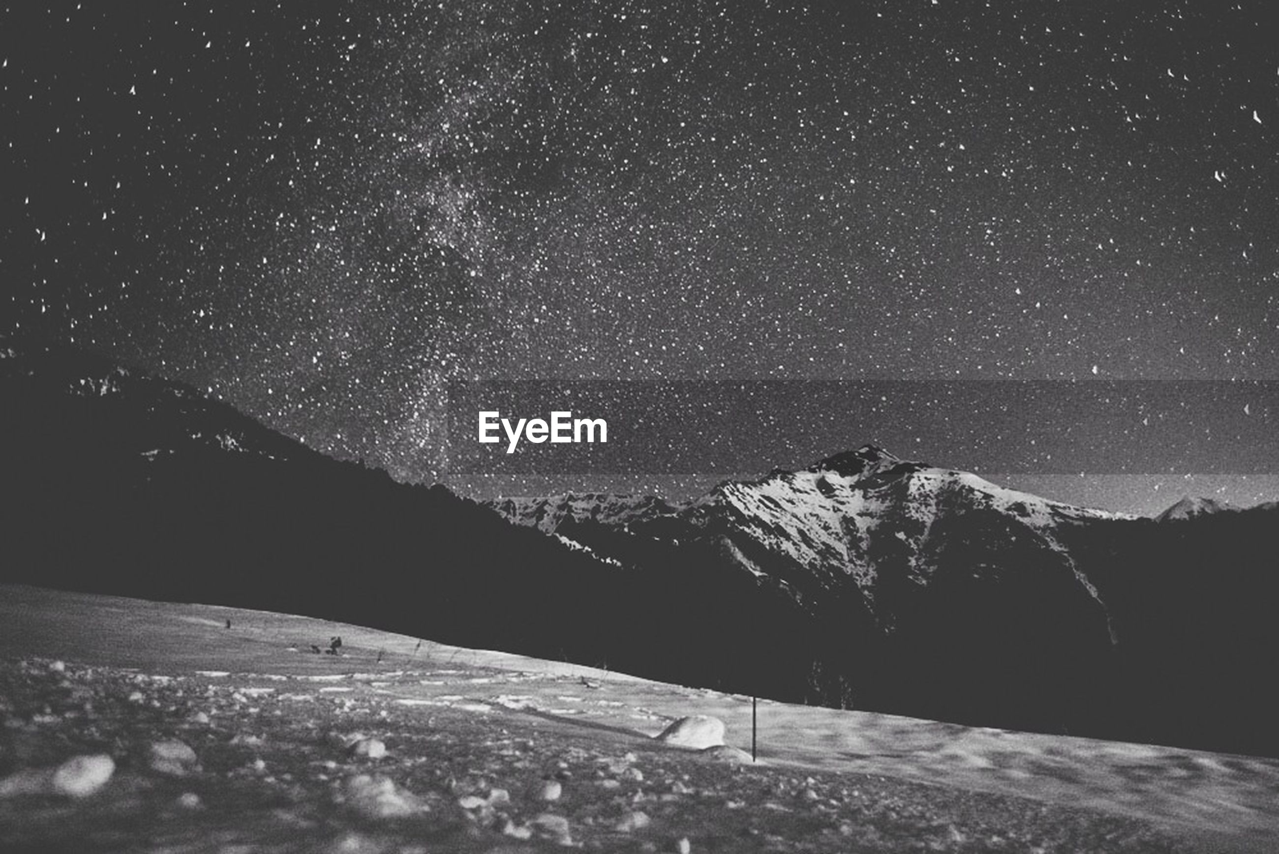Scenic view of mountain against star filled sky