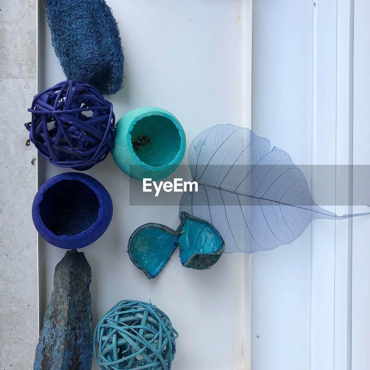 blue, multi colored, indoors, no people, art and craft, craft, creativity, still life, table, choice, textile, close-up, rolled up, variation, directly above, pattern, group of objects, day, wall - building feature, turquoise colored