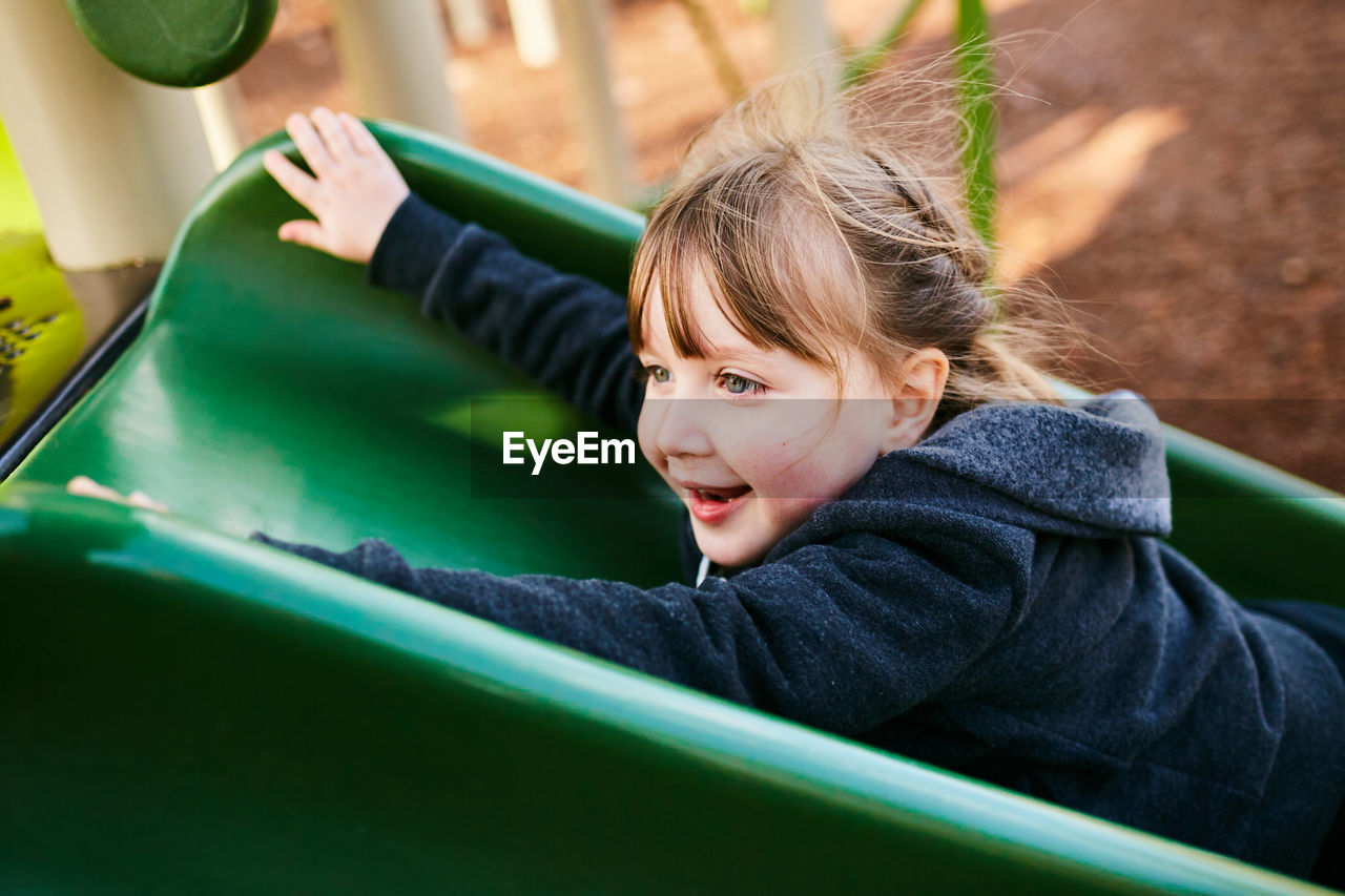 childhood, child, one person, real people, portrait, smiling, lifestyles, happiness, leisure activity, looking at camera, boys, girls, day, casual clothing, females, innocence, emotion, playground, outdoor play equipment