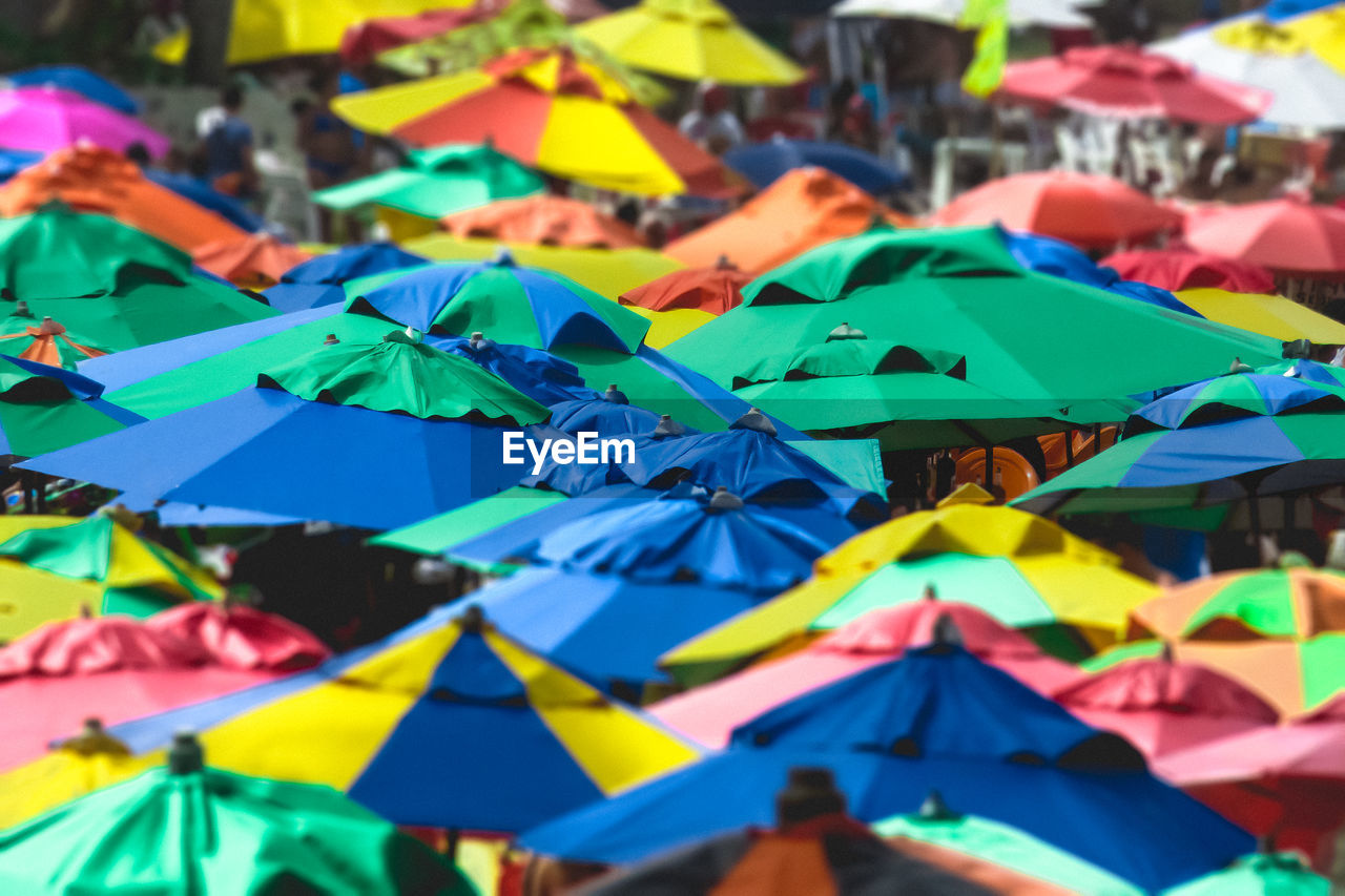 multi colored, full frame, day, large group of objects, close-up, no people, backgrounds, abundance, art and craft, selective focus, umbrella, creativity, focus on foreground, outdoors, still life, variation, choice, paper, market