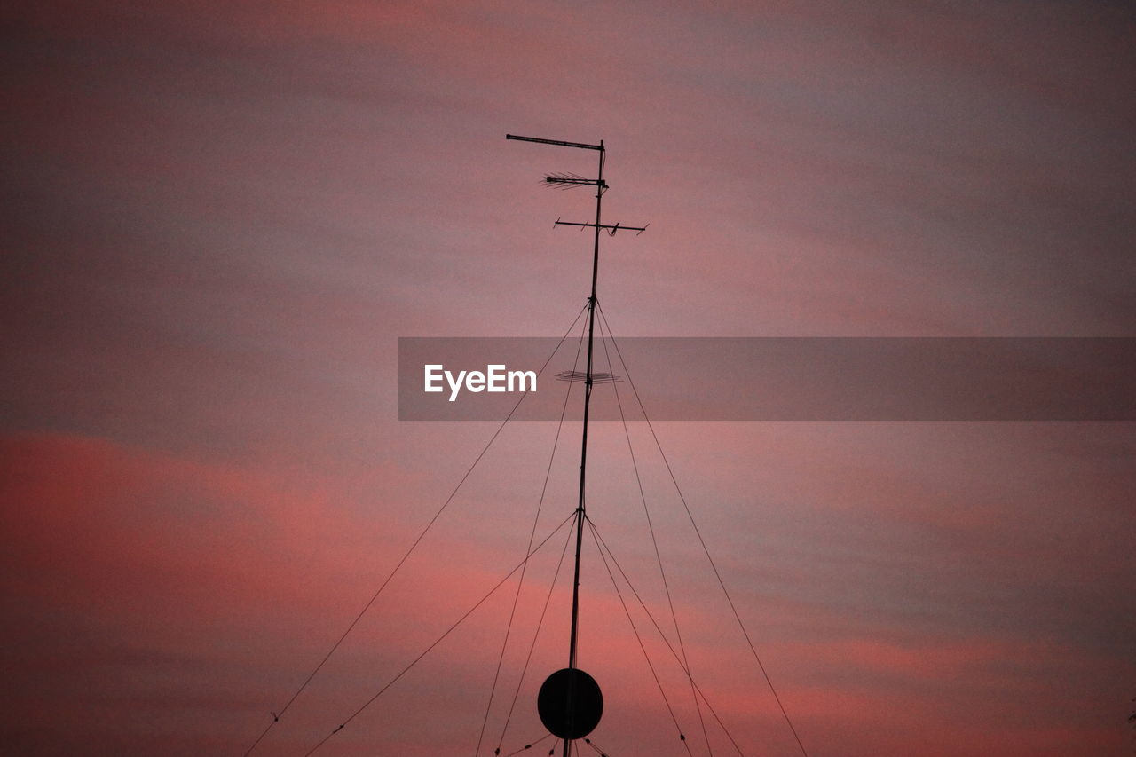 sky, low angle view, sunset, cloud - sky, silhouette, nature, no people, orange color, outdoors, technology, connection, cable, built structure, architecture, fuel and power generation, dusk, transportation, metal, pole, high section, sailboat, power supply