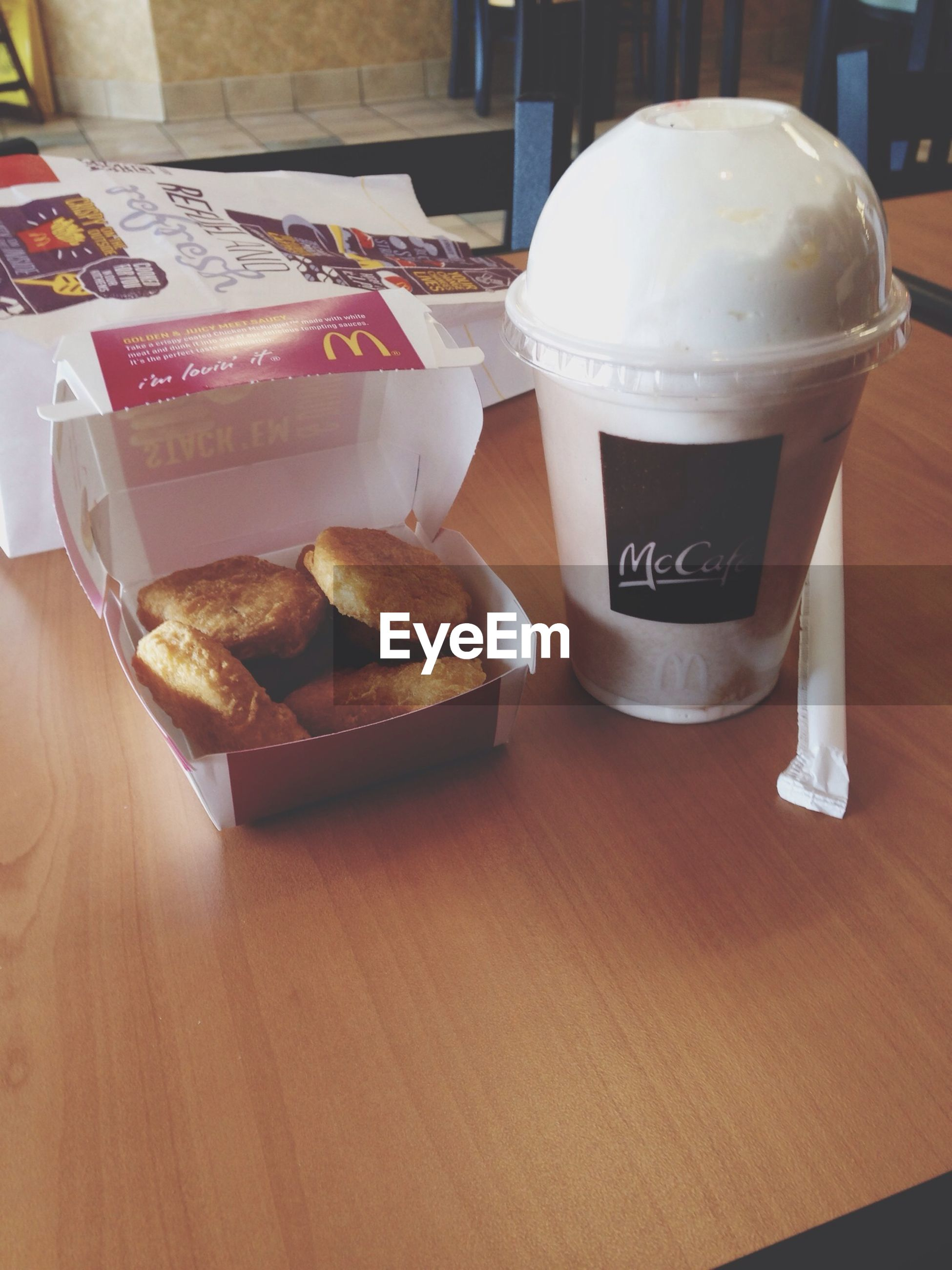 food and drink, indoors, table, drink, freshness, food, refreshment, still life, coffee cup, sweet food, coffee - drink, dessert, text, unhealthy eating, western script, ready-to-eat, indulgence, communication, close-up, cake