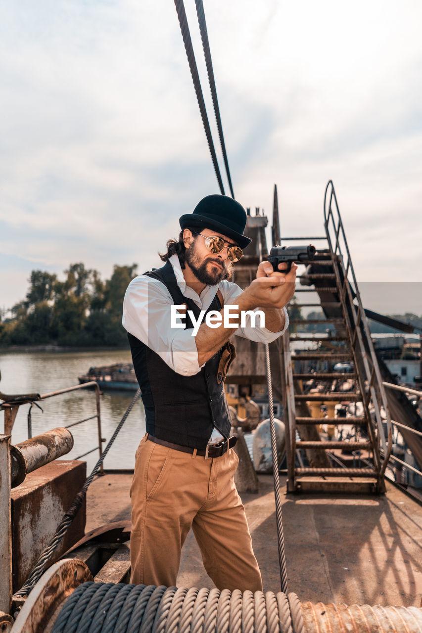 Full length of man standing on boat against sky