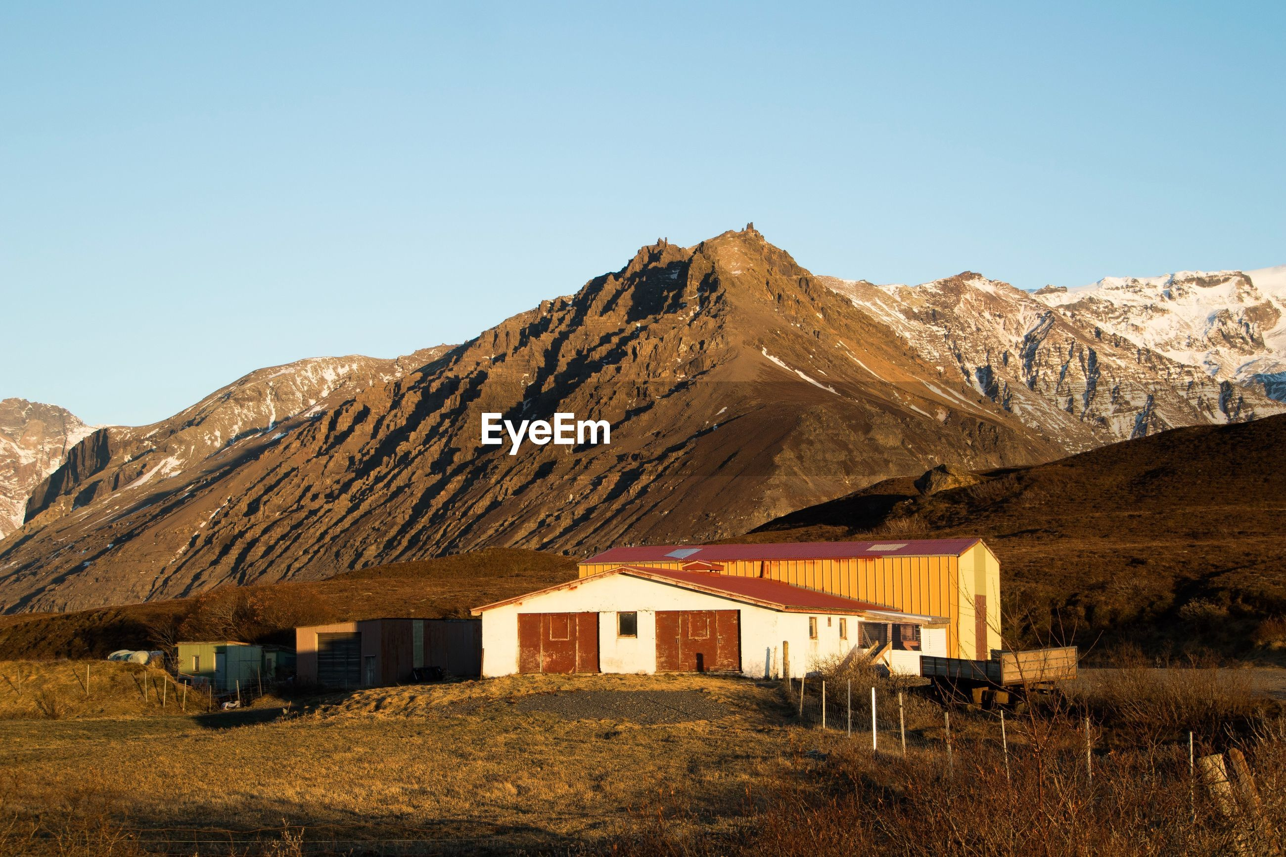 BUILT STRUCTURE ON LAND AGAINST MOUNTAIN RANGE AGAINST CLEAR SKY