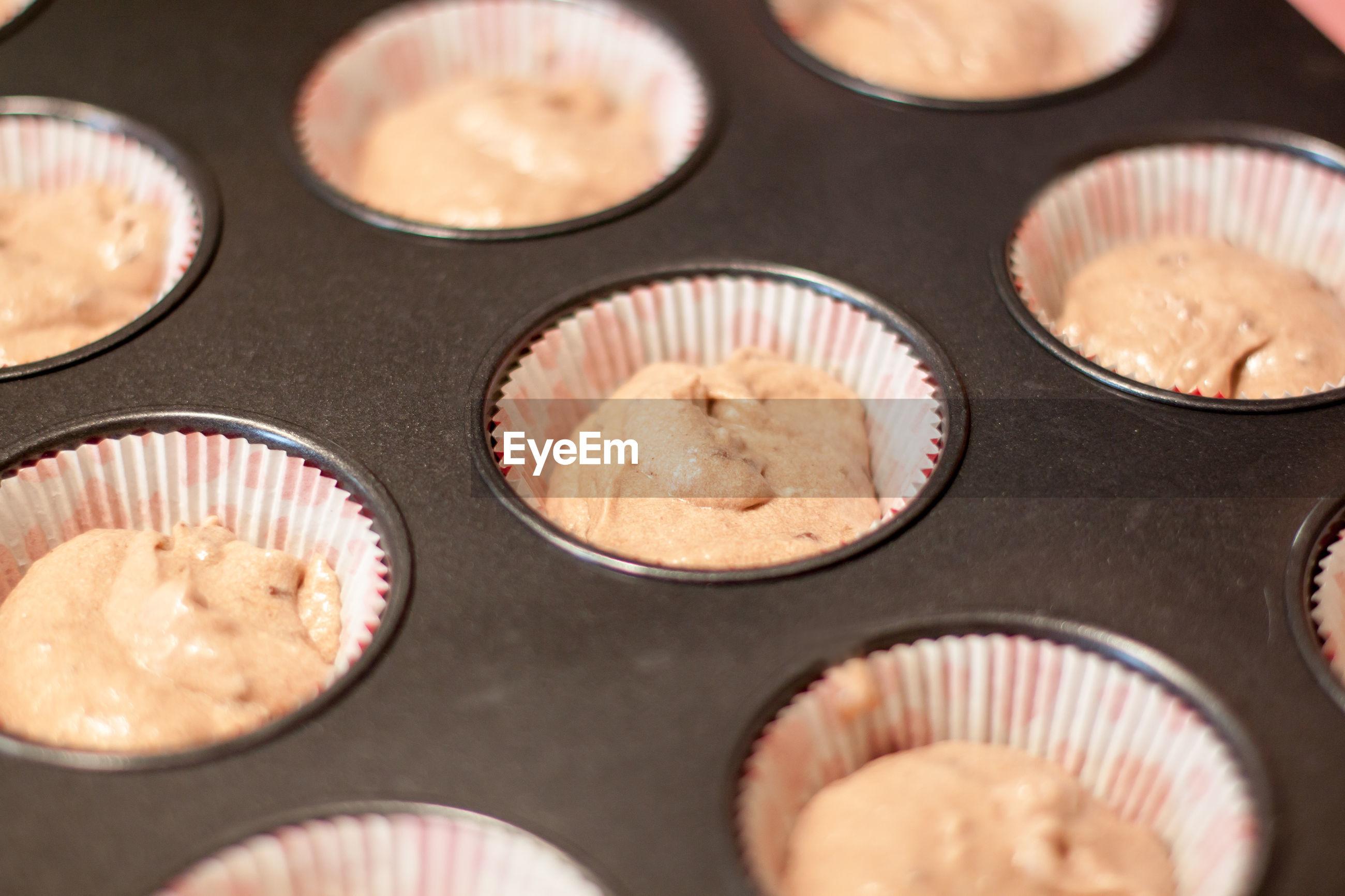 Close-up of muffin dough in baking sheet