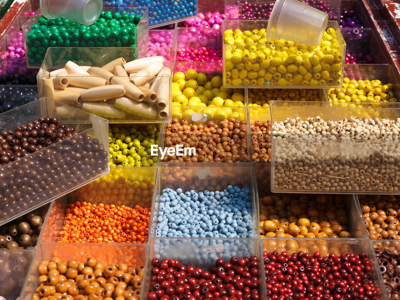 High angle view of colorful beads in containers at store