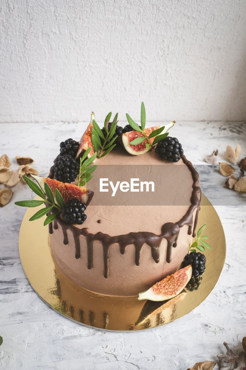 food, indulgence, food and drink, indoors, wall - building feature, no people, leaf, freshness, sweet food, still life, decoration, plant part, celebration, close-up, temptation, baked, creativity, cake, sweet, plant