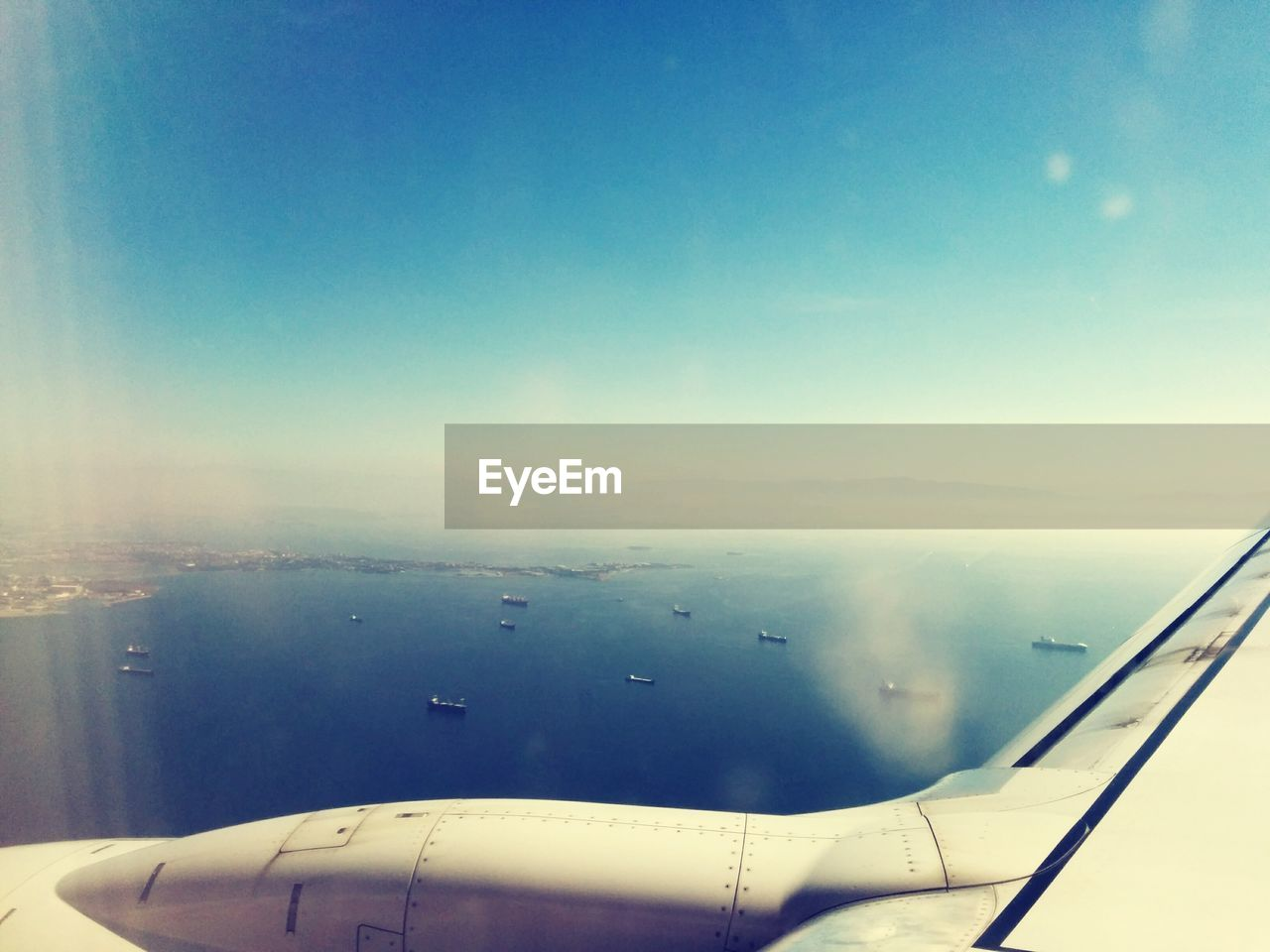 Cropped Image Of Airplane Flying Above Sea