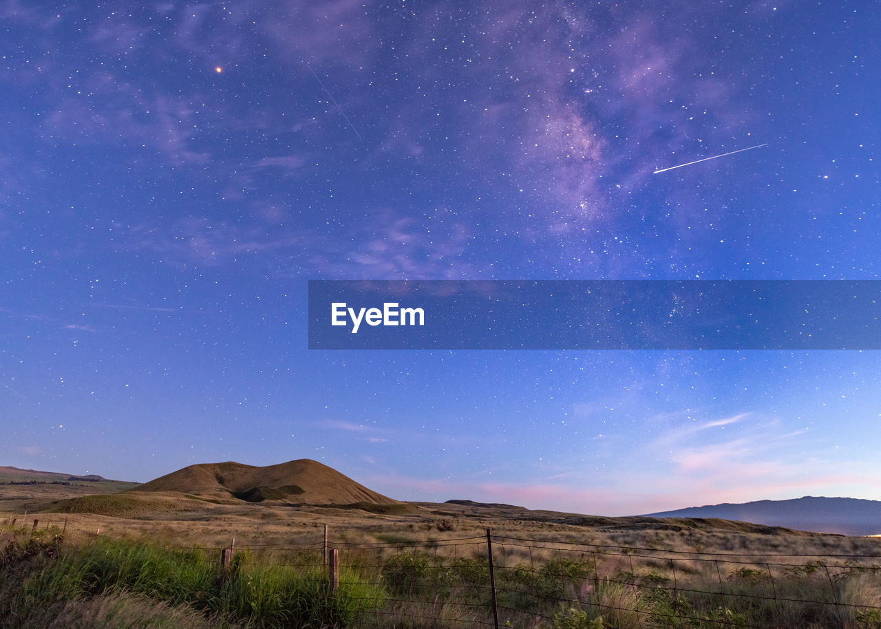 Scenic View Of Star Field Against Sky At Night