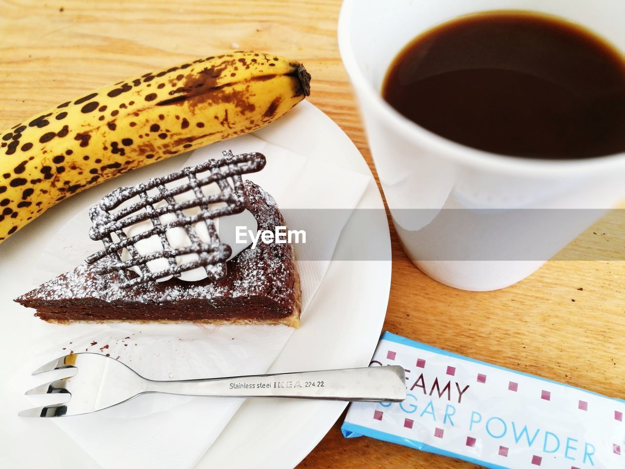 food and drink, table, coffee cup, freshness, coffee - drink, plate, food, sweet food, indoors, indulgence, refreshment, high angle view, no people, close-up, drink, ready-to-eat, dessert, day
