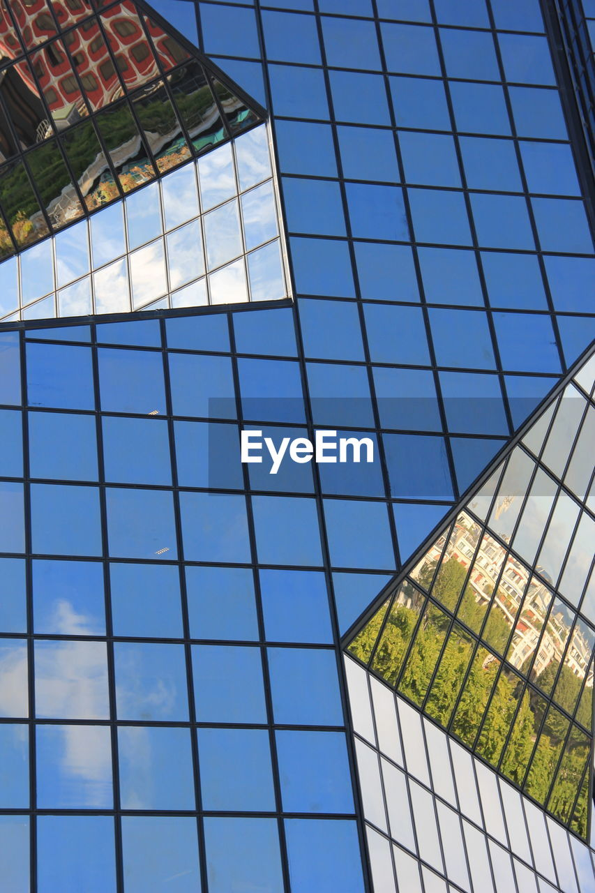 built structure, architecture, building exterior, glass - material, low angle view, modern, window, day, no people, sky, skyscraper, growth, outdoors, clear sky, blue, city