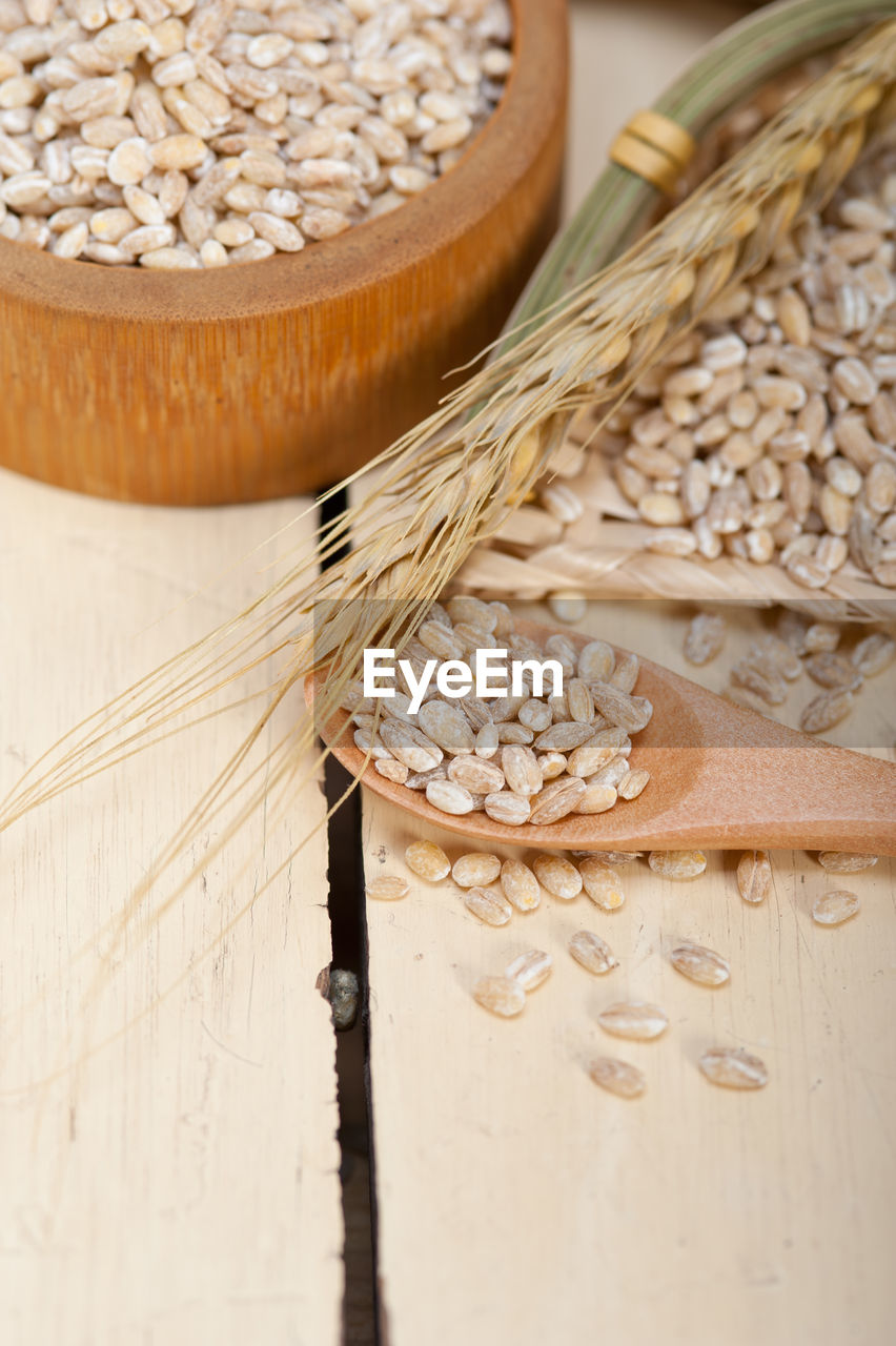 Close-up of wheat grains on table
