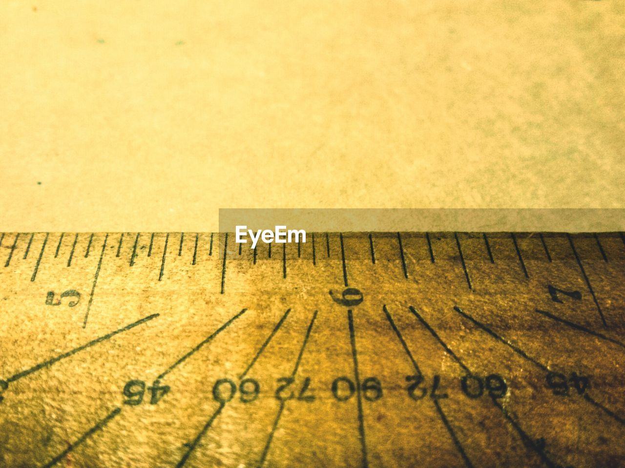 Close-up of wooden ruler on table