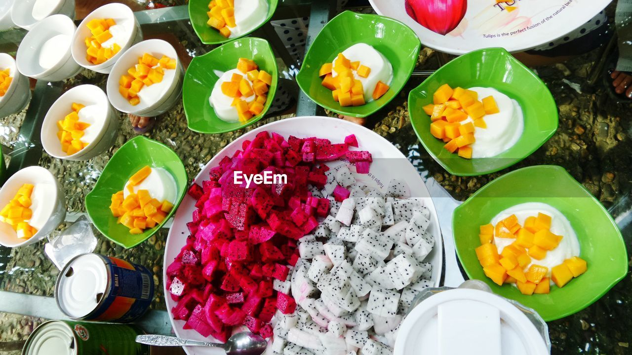 freshness, variation, food and drink, food, high angle view, flower, no people, choice, plate, ready-to-eat, multi colored, day, close-up, healthy eating, indoors, fragility, sweet food