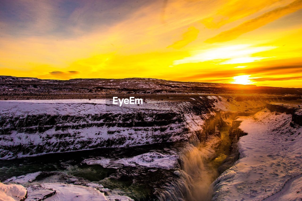 sunset, sky, beauty in nature, scenics - nature, orange color, cloud - sky, water, tranquil scene, tranquility, nature, idyllic, no people, non-urban scene, yellow, cold temperature, winter, sun, land, power in nature, flowing water