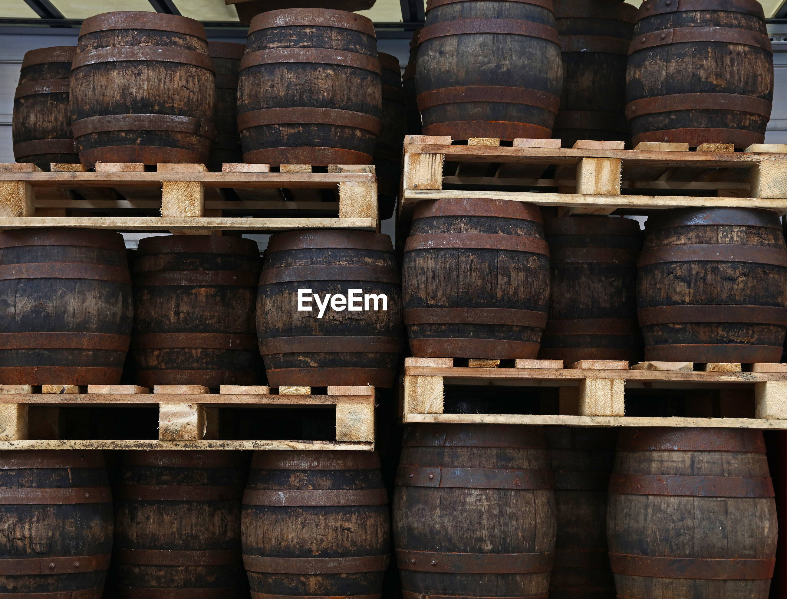 Close-up of barrels in warehouse